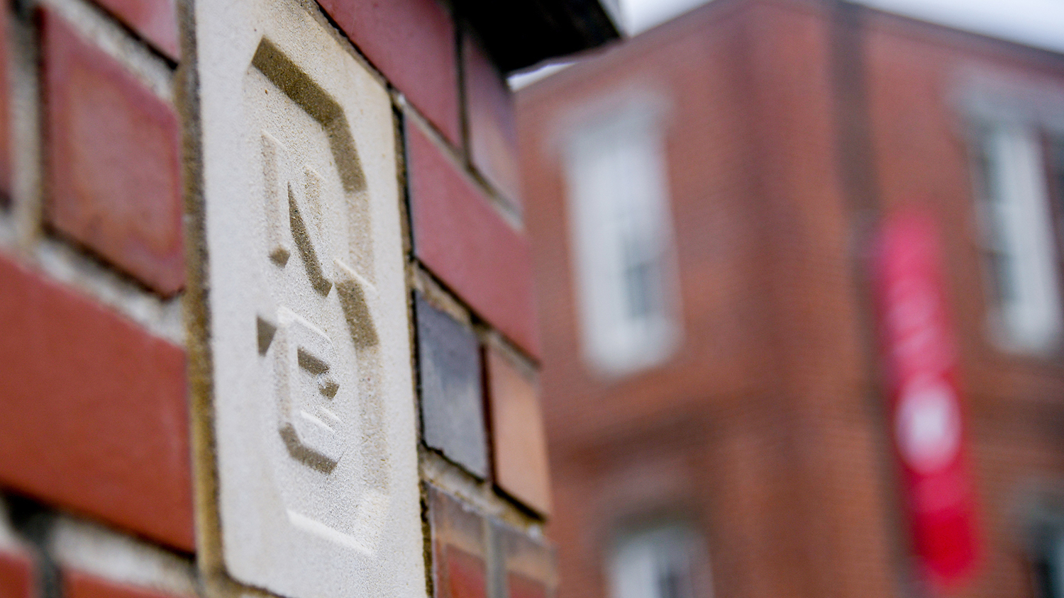 "Close-up of block ""S"" that marks an entrance to main campus."