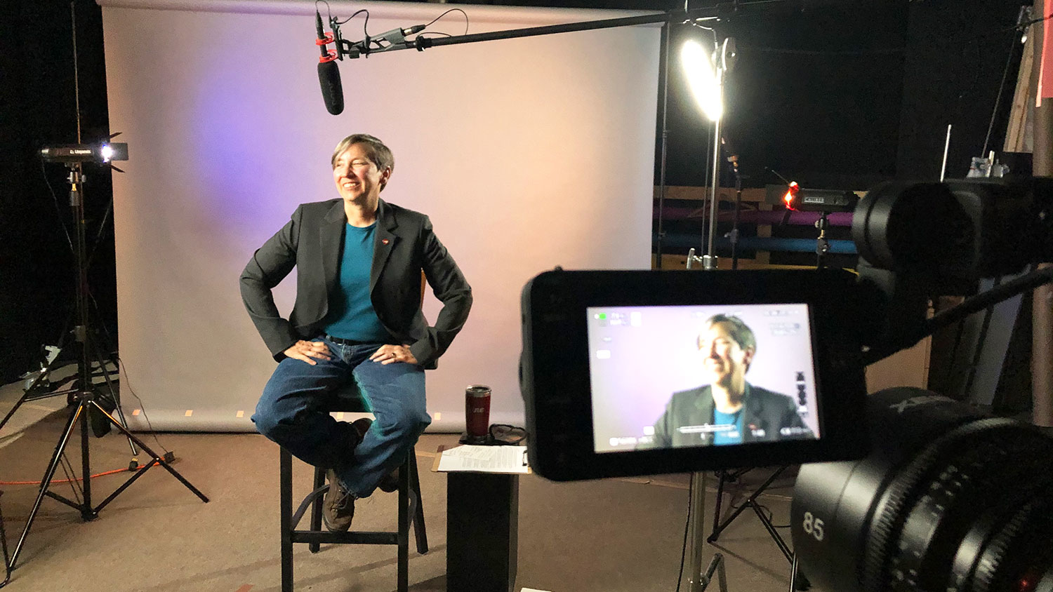 Jane Lubischer filming a segment of the Wicked Problems, Wolfpack Solutions online course