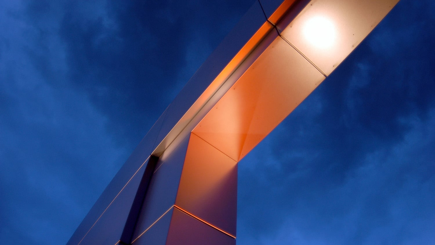 The campus gateway from underneath, against a blue sky